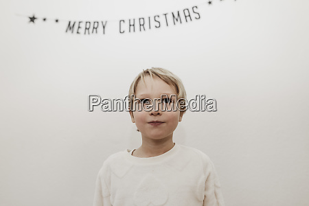 blonde boy looking forward to christmas
