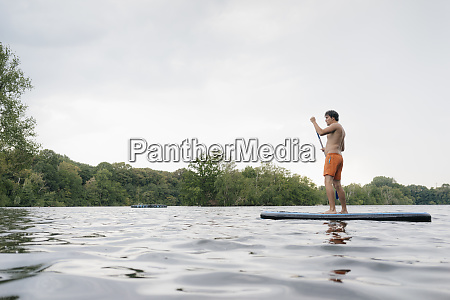 man on sup board on a