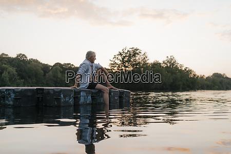 senior man sitting on raft in