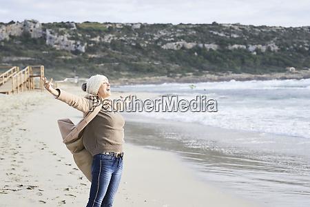spain menorca happy senior man standing