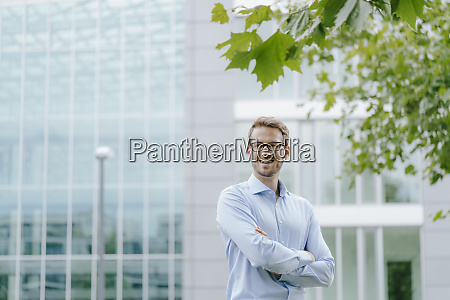 young businessman standing in front of