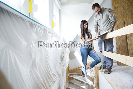 couple in attic to be renovated