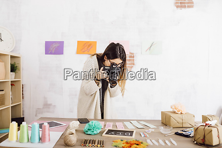 young woman taking pictures with a