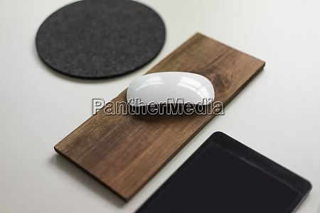 computer mouse on wooden board on