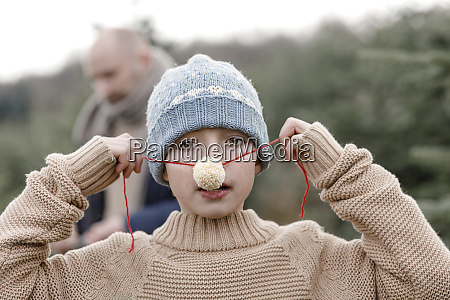 portrait of a boy putting on
