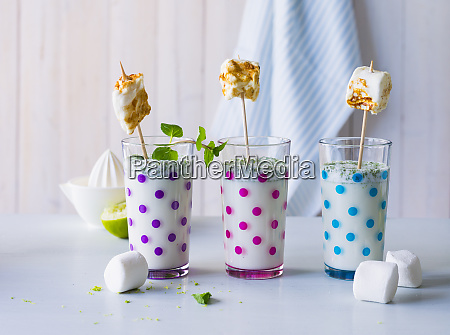 three glasses of buttermilk drink with