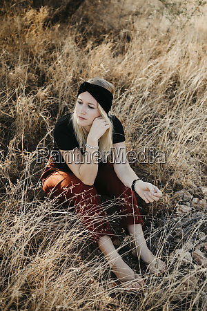 africa namibia blonde woman in grassland