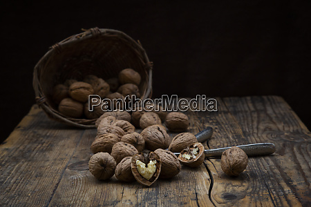 whole and cracked walnuts nutcracker and