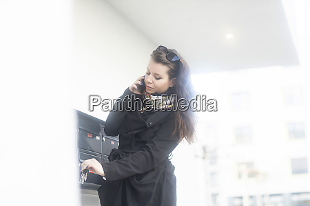young woman on the phone unlocking