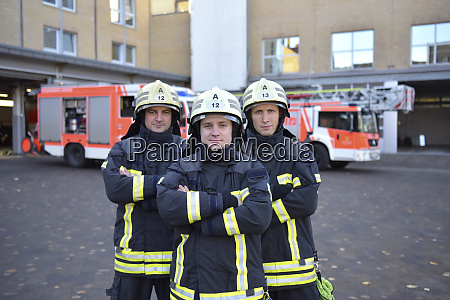 portrait of three confident firefighters standing
