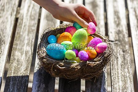girl taking easter egg from easter