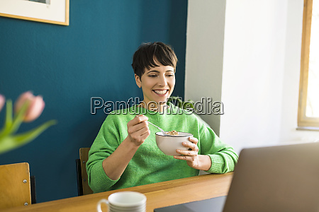happy short haired woman with green