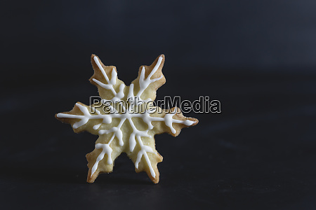 pastry with sugar icing snowflake
