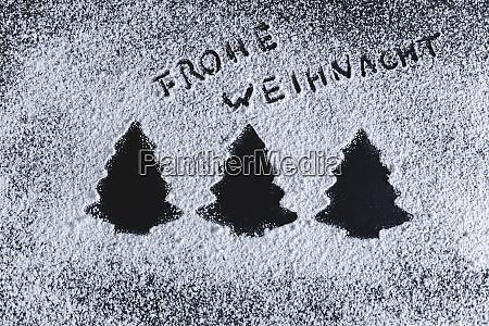 icing sugar on black background fir
