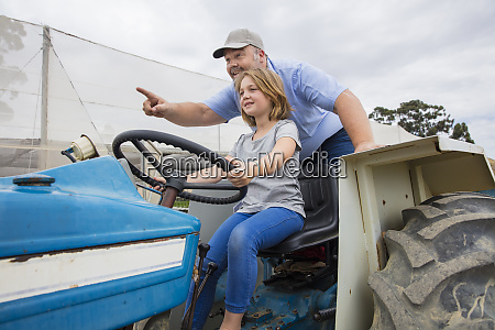 farmer showing his daughter how to