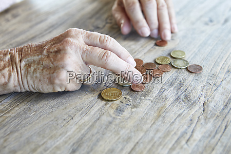 hand of senior woman counting coins