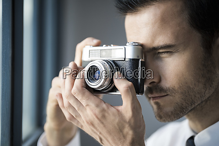 close up of businessman taking picture
