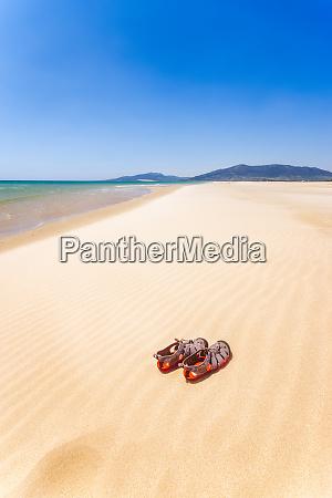 spain andalucia tarifa beach and sandals