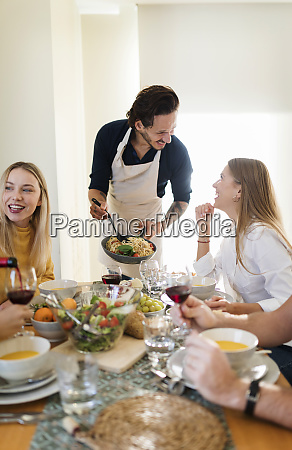 friends having lunch together host serving