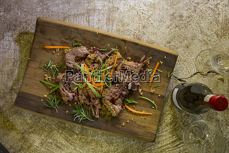 garnished dish on wooden serving plate