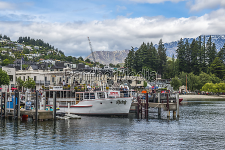 queenstown pier and neighbouring mountain slopes