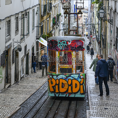 street car with graffiti going downhill