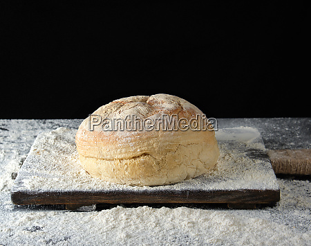 round baked bread and white wheat