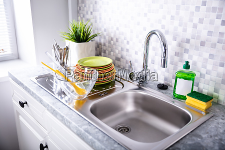 utensils near sink and faucet
