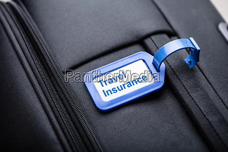 travel insurance label with suitcase bag