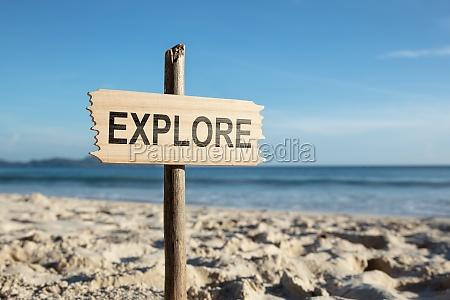 explore pole on sandy beach