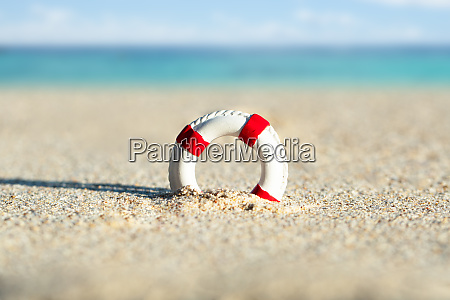 lifebuoy dig in the sand at