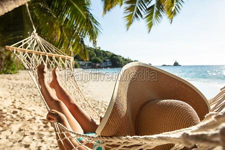 woman in bikini lying on hammock