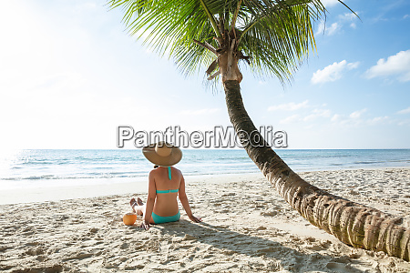 woman with coconut water sitting on