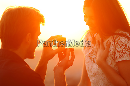 silhouette of a marriage proposal at