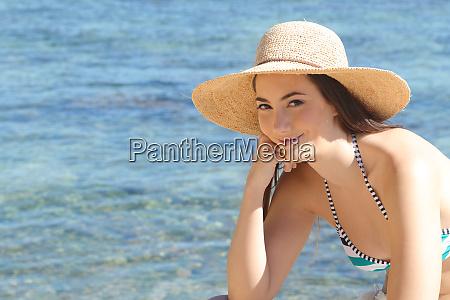 tourist in bikini looks at camera