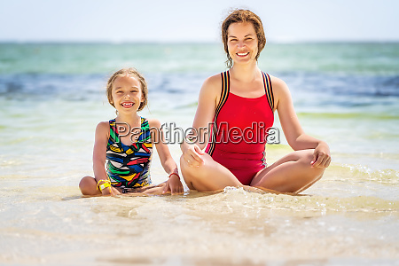young mother and little daughter enjoying