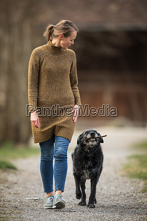 young woman walking her dog after