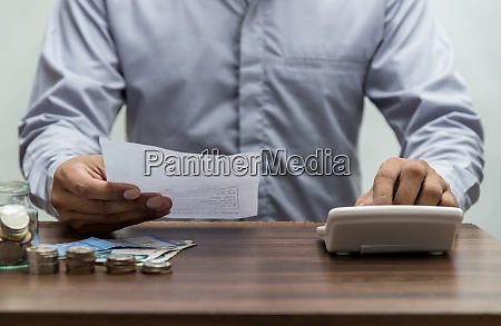 man with bill and stack of