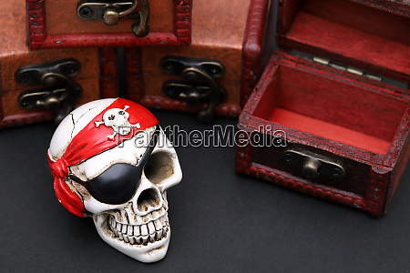 skeleton pirate with treasure chest on