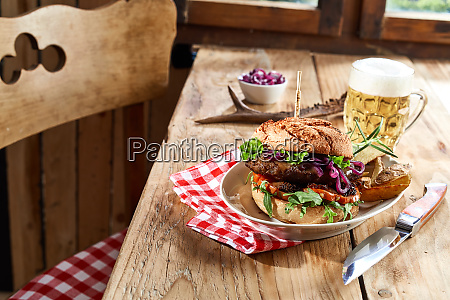 speciality venison beef burger with frothy