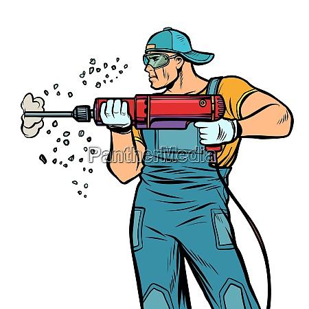 man builder worker drills puncher wall