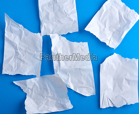 crumpled empty torn pieces of white