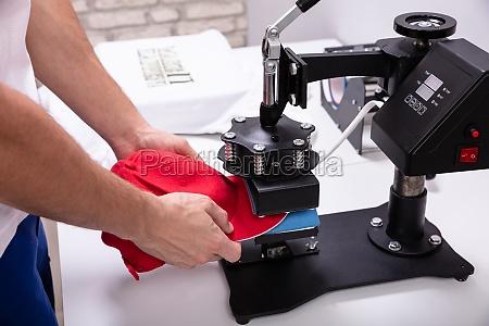 printing on baseball cap in workshop