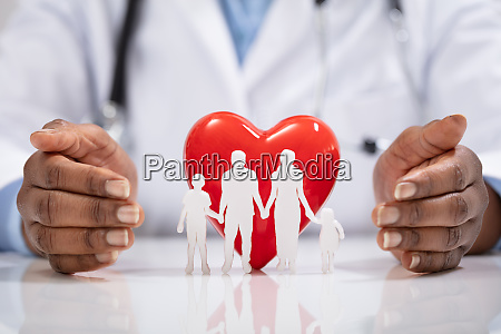 doctor protecting family cut out and
