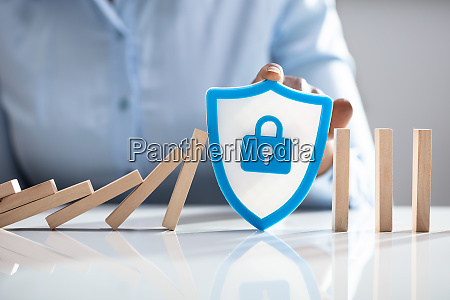 woman with shield security icon stopping