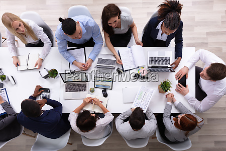 an overhead view of businesspeople in