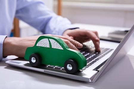 green car on laptop keypad