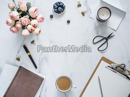 flat lay feminine home office copy