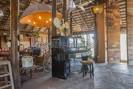 piano and props in country loft