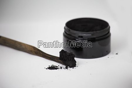 charcoal on a toothbrush to whiten